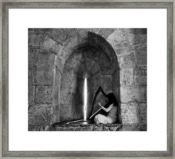 The Harp Player Framed Print