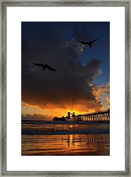 The Jutting Pier At Sundown  Framed Print by Donna Pagakis