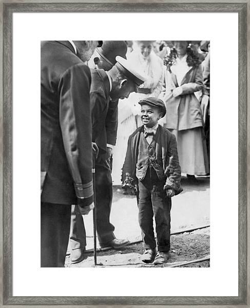 The King And A Working Boy Framed Print