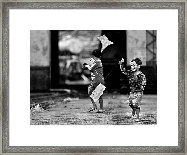 The Kite Runner Framed Print by Sebastian Kisworo