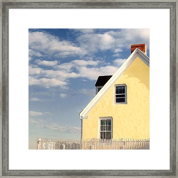 The Little Yellow House At The Seawall Framed Print