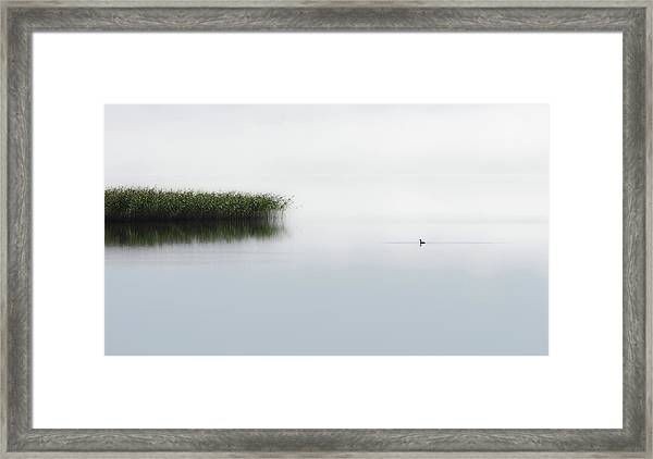 The Lone Fisher Framed Print