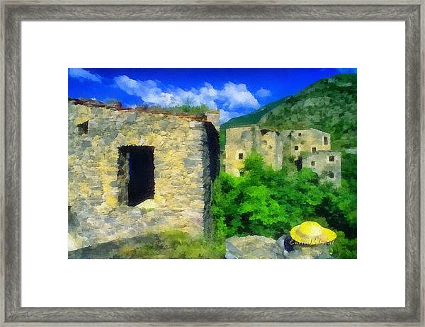 The Old Village And The Yellow Hat Framed Print
