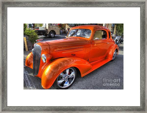 The Orange Phantom Framed Print