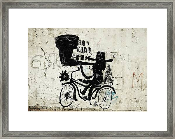 The Picture Shows A Man Who Rides A Framed Print