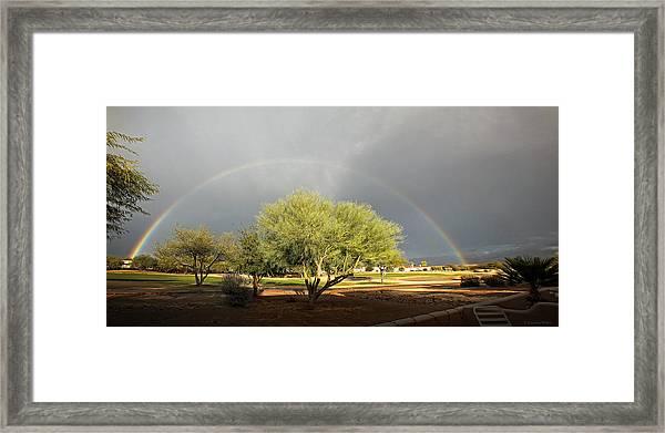 The Rain And The Rainbow Framed Print