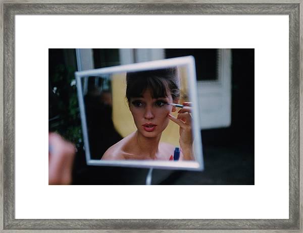 The Reflection Of A Model Applying Make-up Framed Print by Karen Radkai
