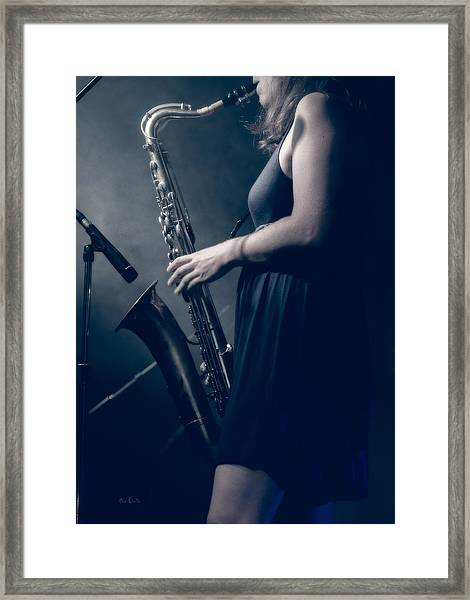 The Saxophonist Sounds In The Night Framed Print