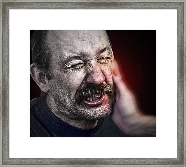The Slap Framed Print