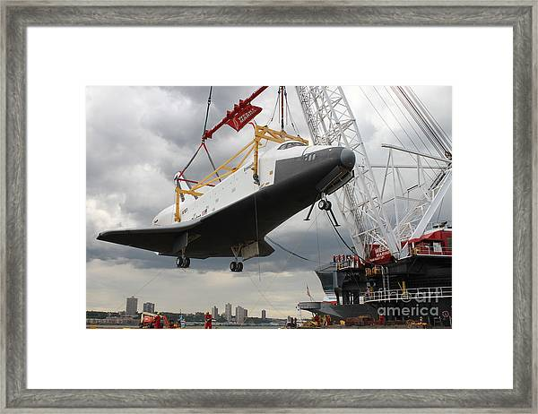 The Space Shuttle Lifted Up To The Intrepid Framed Print