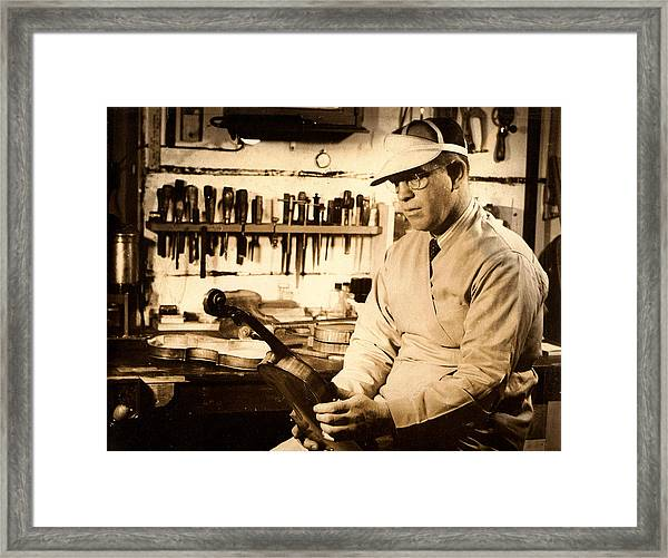 The Violin Maker Framed Print