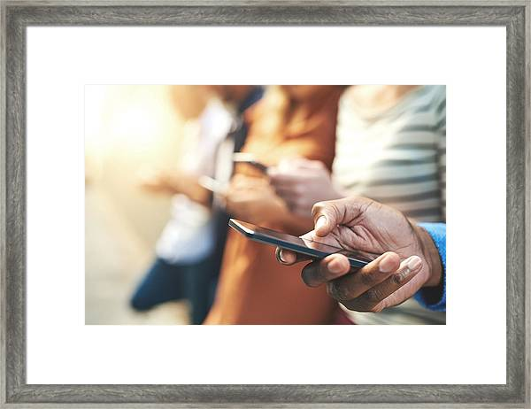These Days Fingers Do The Talking Framed Print by PeopleImages
