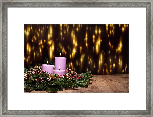 Three Candles In An Advent Flower Arrangement Framed Print
