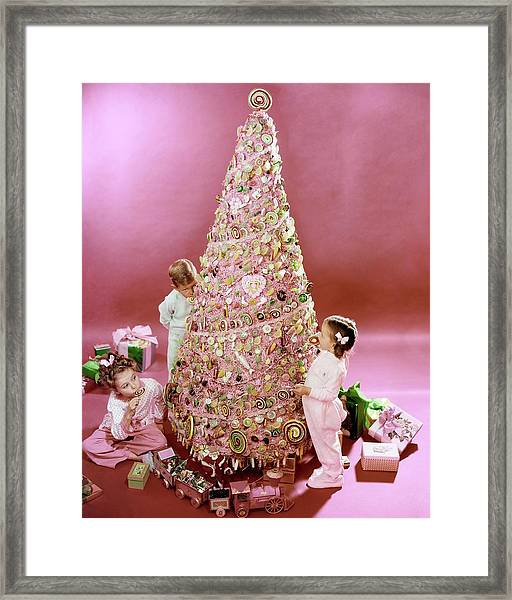 Three Children Eating A Candy Christmas Tree Framed Print by Herbert Matter