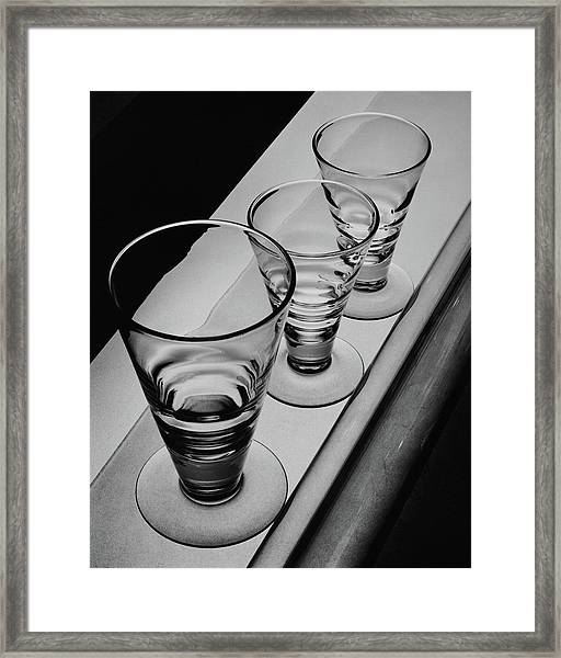 Three Glasses On A Shelf Framed Print