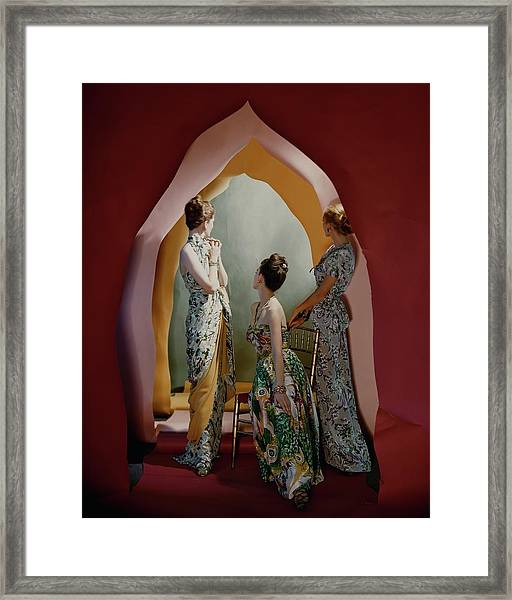 Three Models Wearing Patterned Dresses Framed Print