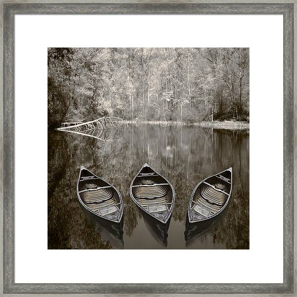 Three Old Canoes Framed Print