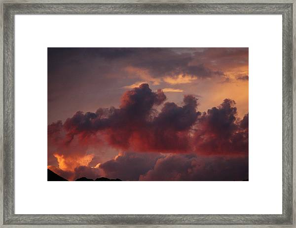 Three Sister Clouds Framed Print