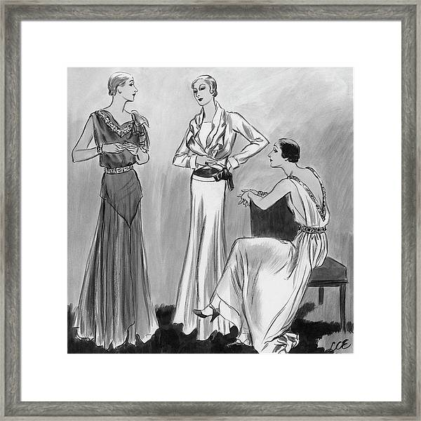 Three Women Wearing Designer Evening Gowns Framed Print