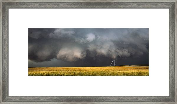 Thunderstorm Advancing Over A Field Framed Print