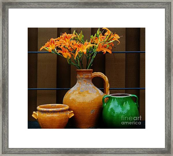Tigerlilies And Pottery Framed Print by Marsha Heiken
