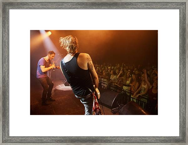 Time To Rock Out With A Solo... Framed Print by PeopleImages