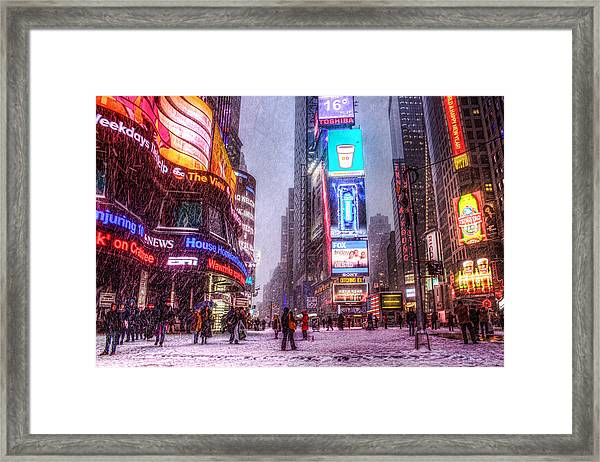 Times Square In The Snow Framed Print by Zev Steinhardt