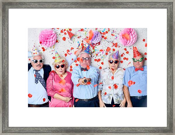 Tired Seniors After Christmas Party Framed Print by Mediaphotos