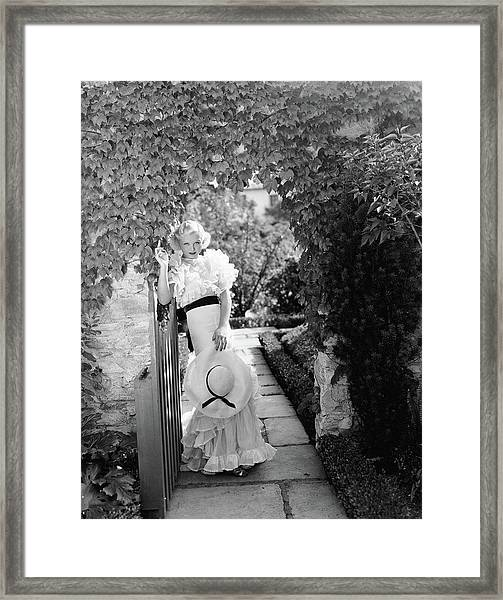 Toby Wing Standing In A Garden Gateway Framed Print