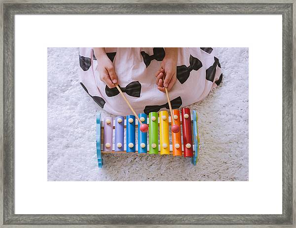Toddler Playing A Xylophone At Home Framed Print by Suphat Bhandharangsri Photography