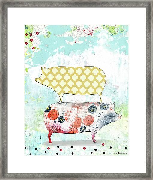 Totem Pigs Framed Print