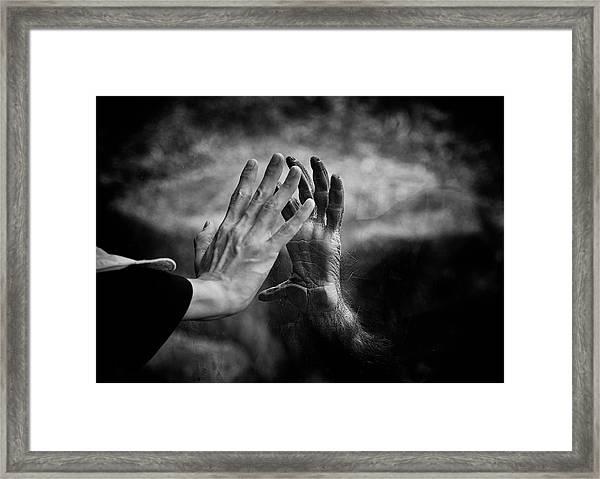 Touching Framed Print