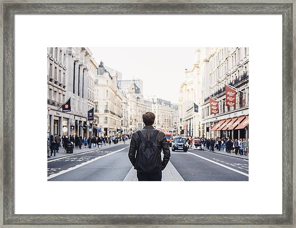 Tourist With Backpack Walking On Regent Street In London, Uk Framed Print by Alexander Spatari