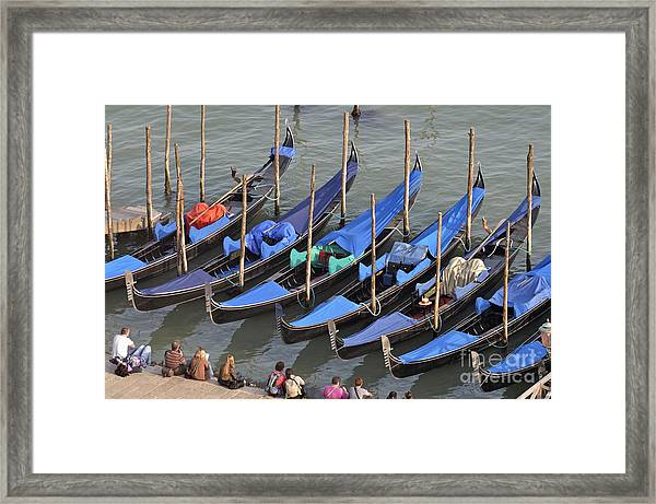 Tourists And Row Of Empty Moored Gondolas Framed Print by Sami Sarkis