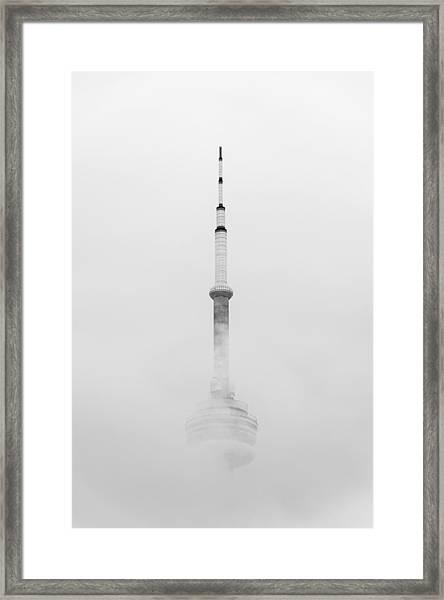 Towering Through The Fog Framed Print