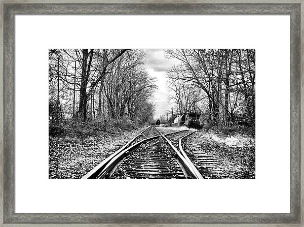 Tracks Of History Framed Print by John Rizzuto