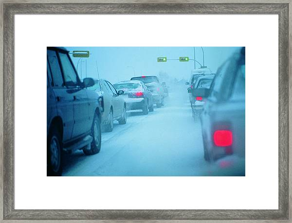 Traffic Jam In Snowy Conditions Framed Print by Digital Vision.