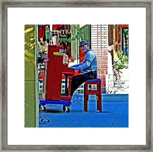 Traveling Piano Player Framed Print