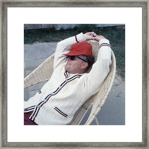 Truman Capote Leaning Back In A Chair Framed Print