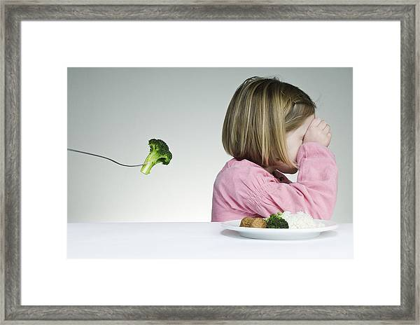 Trying To Get A Child To Eat Her Greens Framed Print by ClarkandCompany