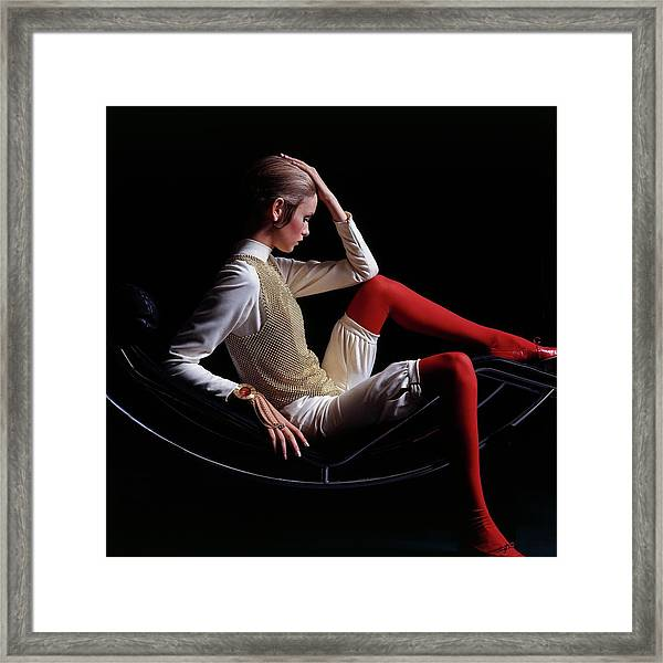 Twiggy Sitting On A Modern Chair Framed Print