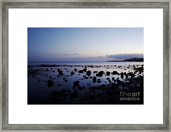 Twilight Glow Over Ocean Framed Print
