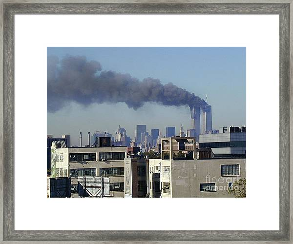 Twin Towers Burning Framed Print