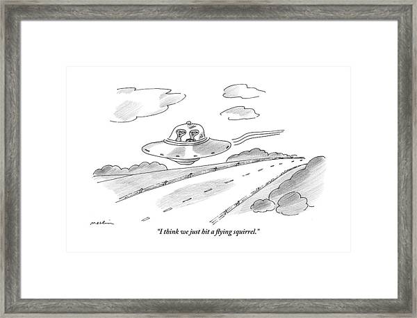 Two Aliens Fly A Saucer Down A Highway Framed Print