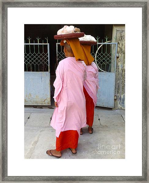Two Buddhist Nuns Collecting Food Donation From Locals 75th Street Mandalay Burma Framed Print by PIXELS  XPOSED Ralph A Ledergerber Photography