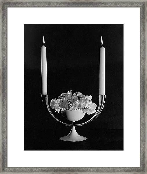 Two Burning Candles And And Some Flowers Framed Print by John Rawlings