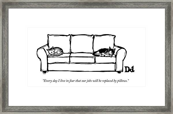 Two Cats Curl Up At Each End Of A Sofa Framed Print