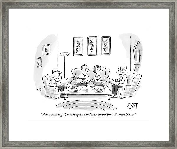 Two Couples Are Sitting Around A Coffee Table Framed Print