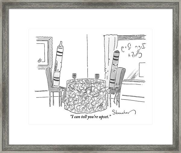 Two Crayons Sit Across From Each Other At A Round Framed Print