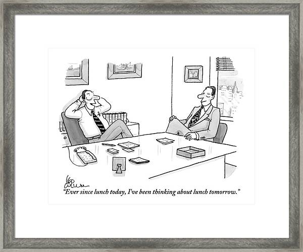 Two Executives In Suits Sit At A Business Table Framed Print